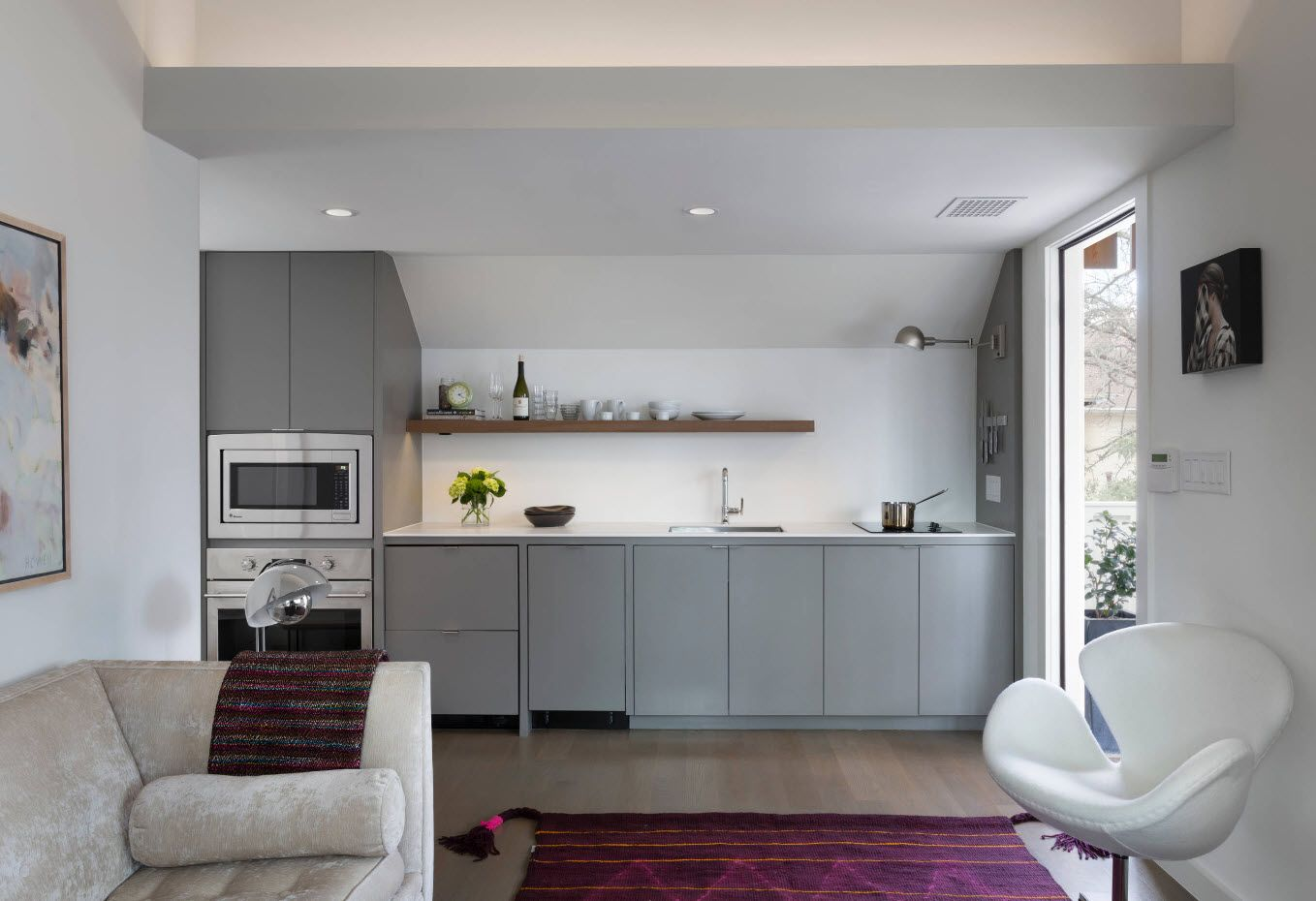 Neat white wall decoration and gray facades of the kitchen