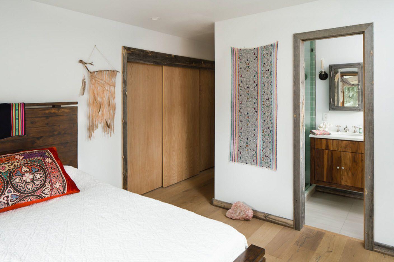 White bedroom with ethnoc motives