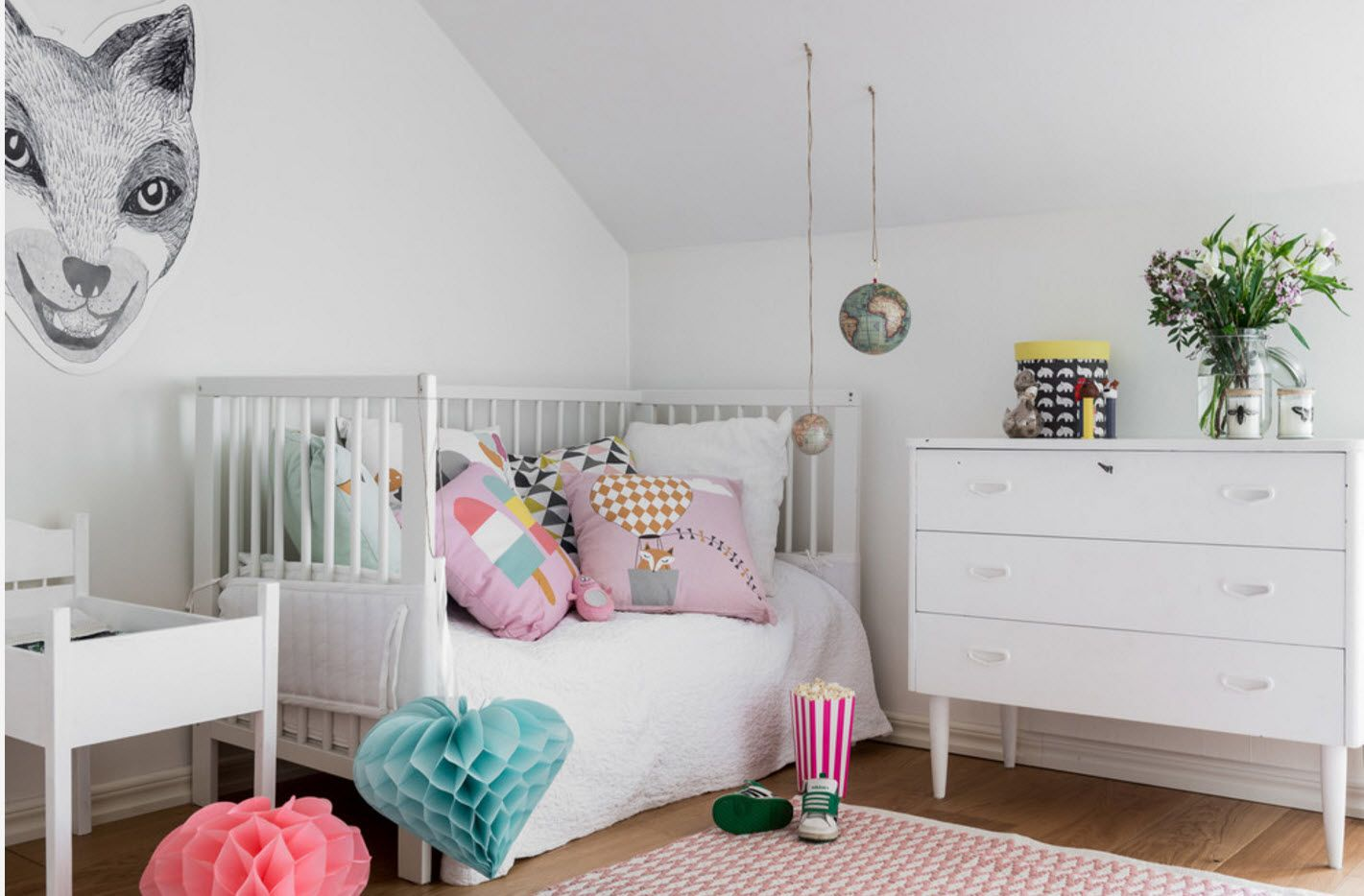 White color palette and colorful toys to dilute the interior
