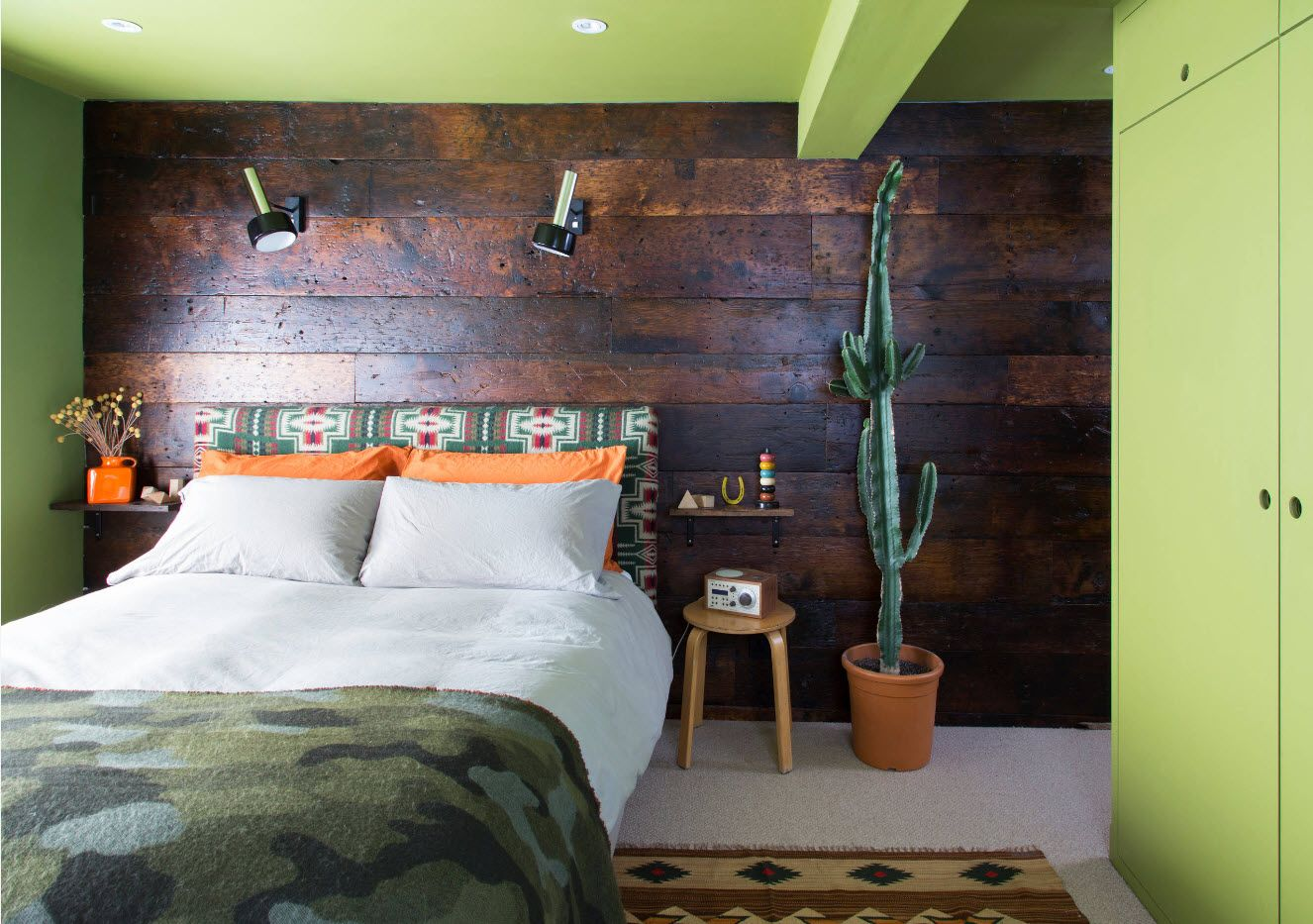 Wall decoration with large planks in eco styled bedroom