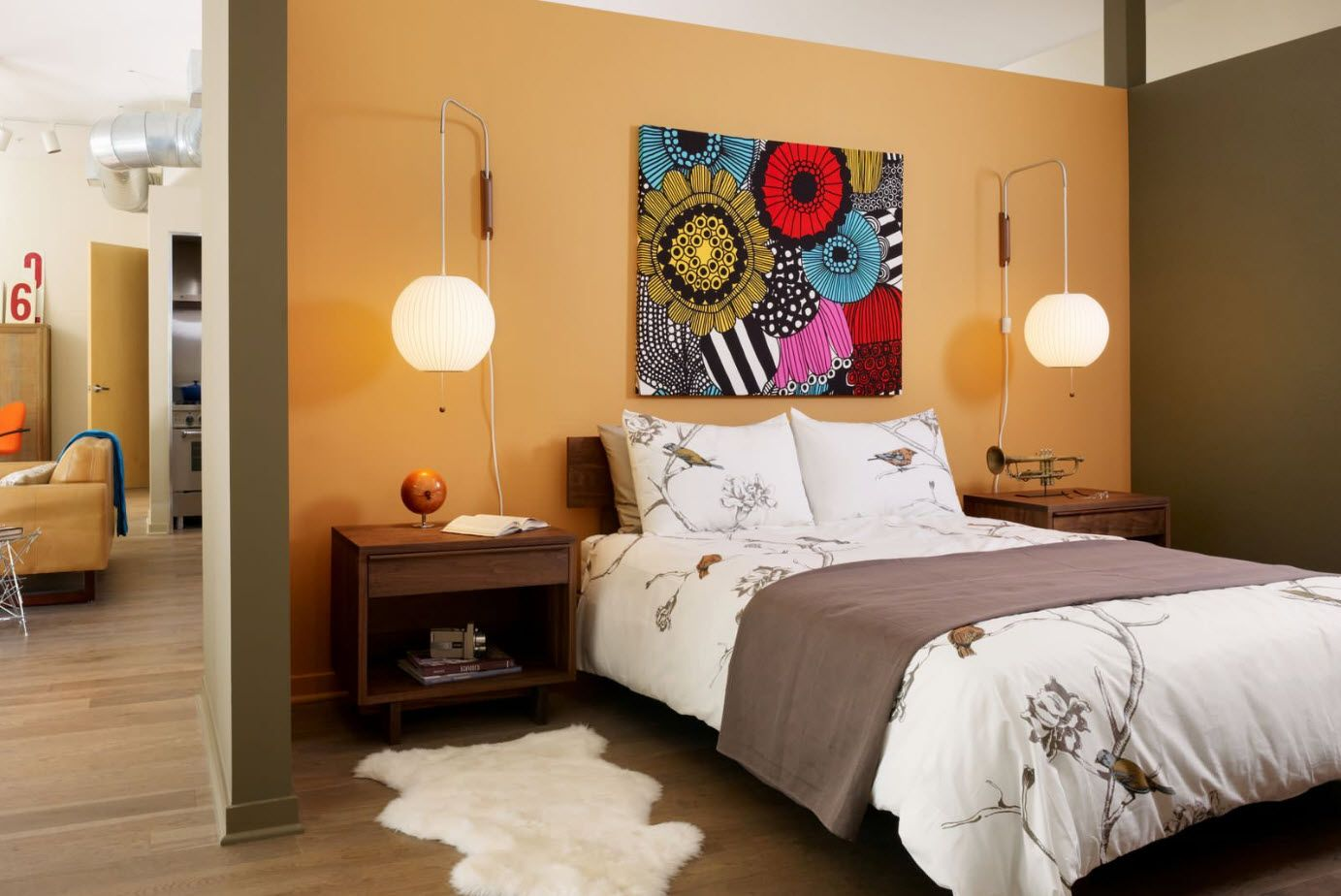 Nice expressionistic picture at the headboard and on peach colored wall