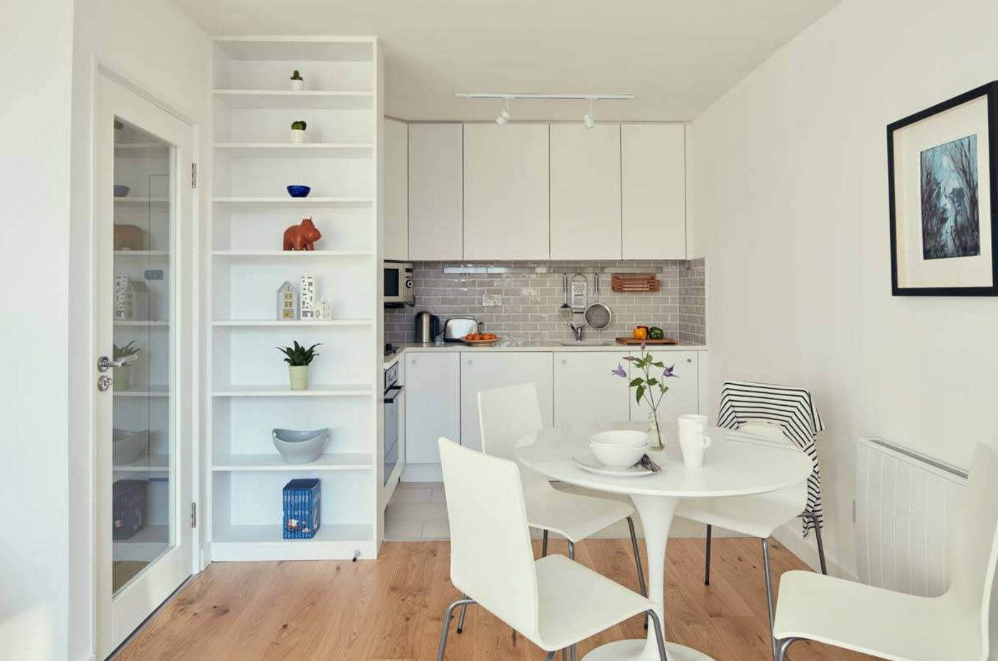 Open shelving at the white kitchen decorated by canons of classic style using modern materials