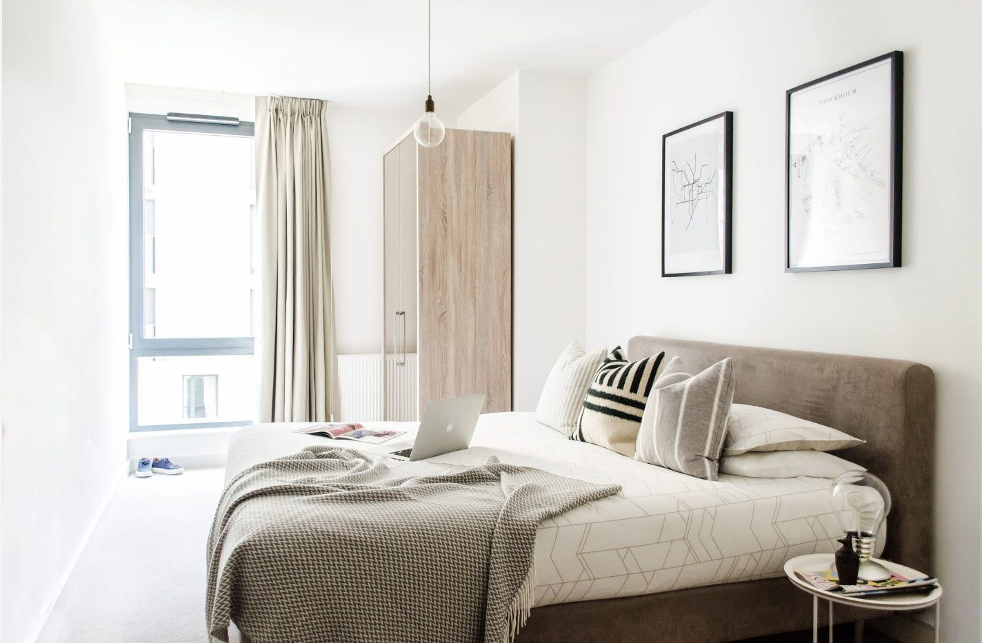 Large pictures and wooden surfaces of the modern bedroom 2017