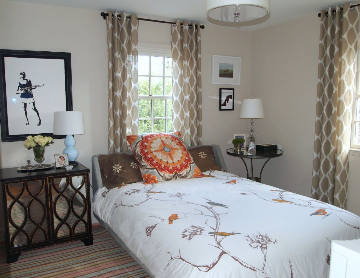 Typical neat classic interior in the small bedroom with dotted braown grommet top drapes