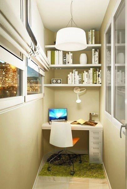 Balcony home office with pastel finishing and white storage systems