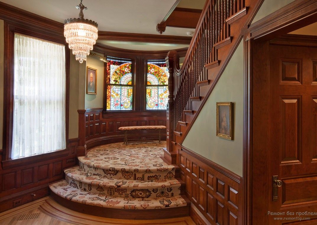 Staircase and the hall in noble red wood