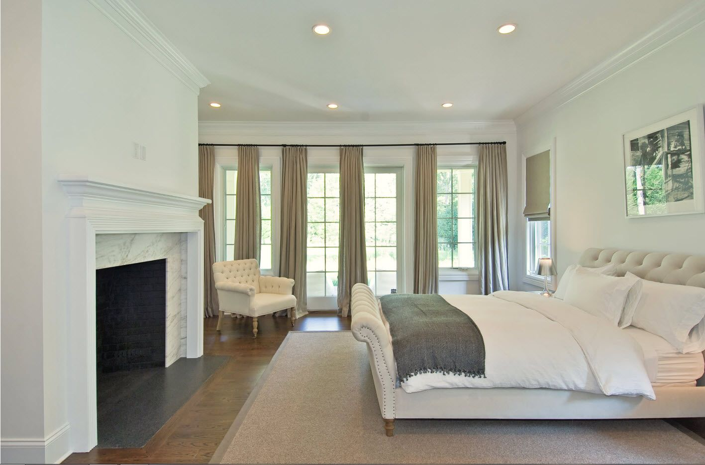 Sapcious modern interior of the royal finished bedroom with fireplace