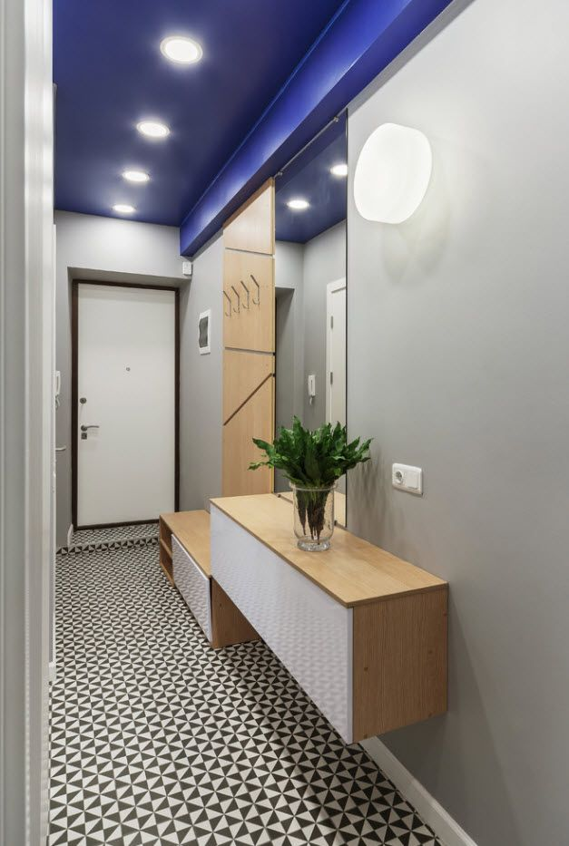 Gray walls and airy vanity in the hallway