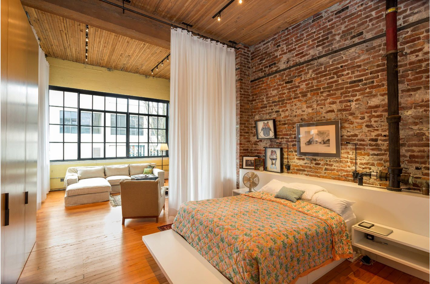 Really spectacular loft example of the bedroom design with brickwork
