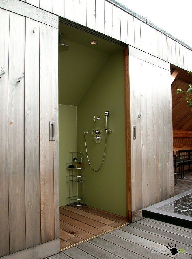 Entrance to the outdoor shower with wooden door