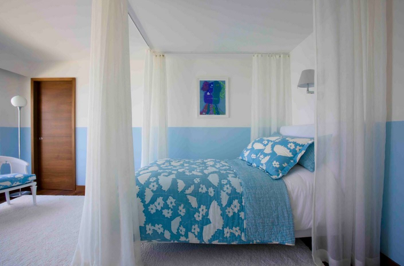 Blue and white color theme for the modern bedroom with canopy