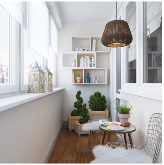 White Scandinavian interior with plants, shelves and smooth surfaces and DIY lampshade