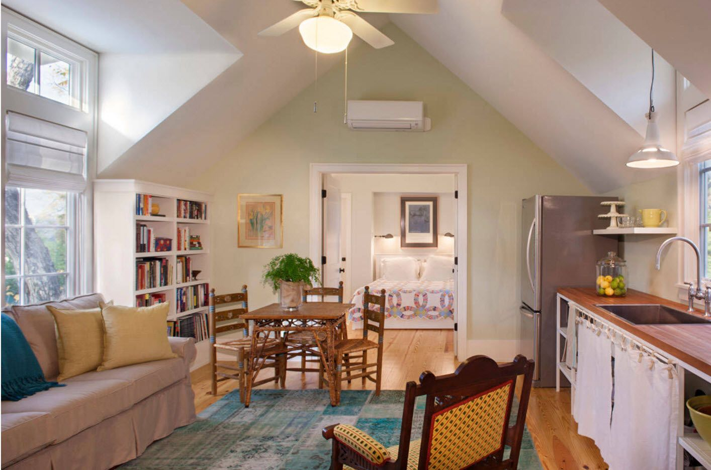 Peculiarly vaulted ceiling in the modern set common space of studio apartment