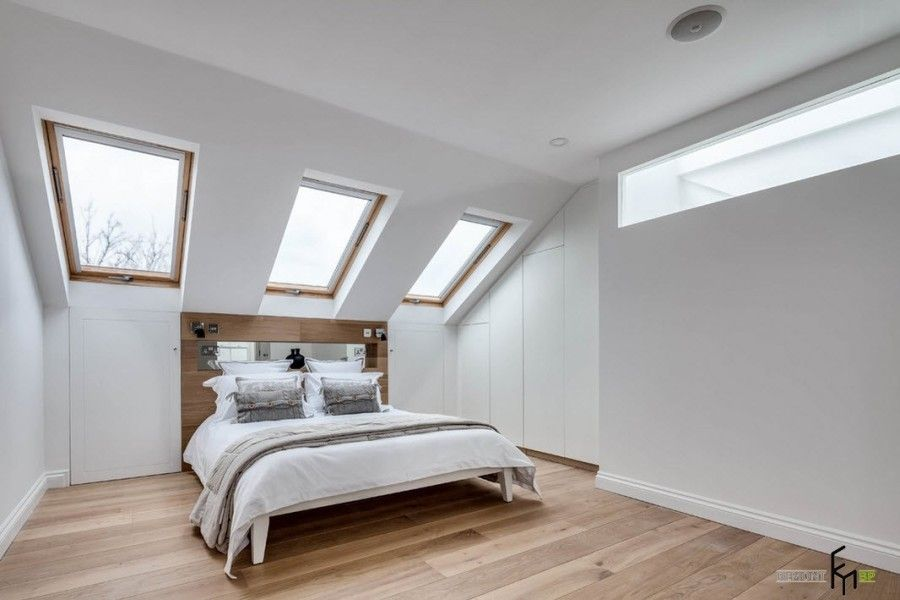 Modern English Country Style Interior Design Example. Skylight at the slanted ceiling of the master bedroom