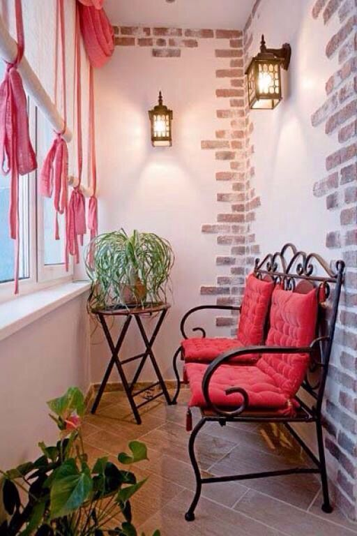 Red furniture theme for pastel colored balcony