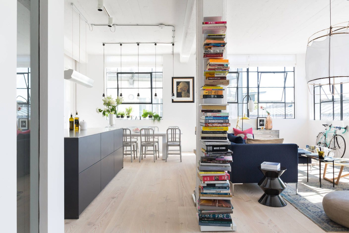 Gorgeous design solution of the studio apartment to store books