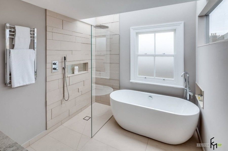 Modern English Country Style Interior Design Example. Master bathroom with frosted glass window and textured wall at the shower zone