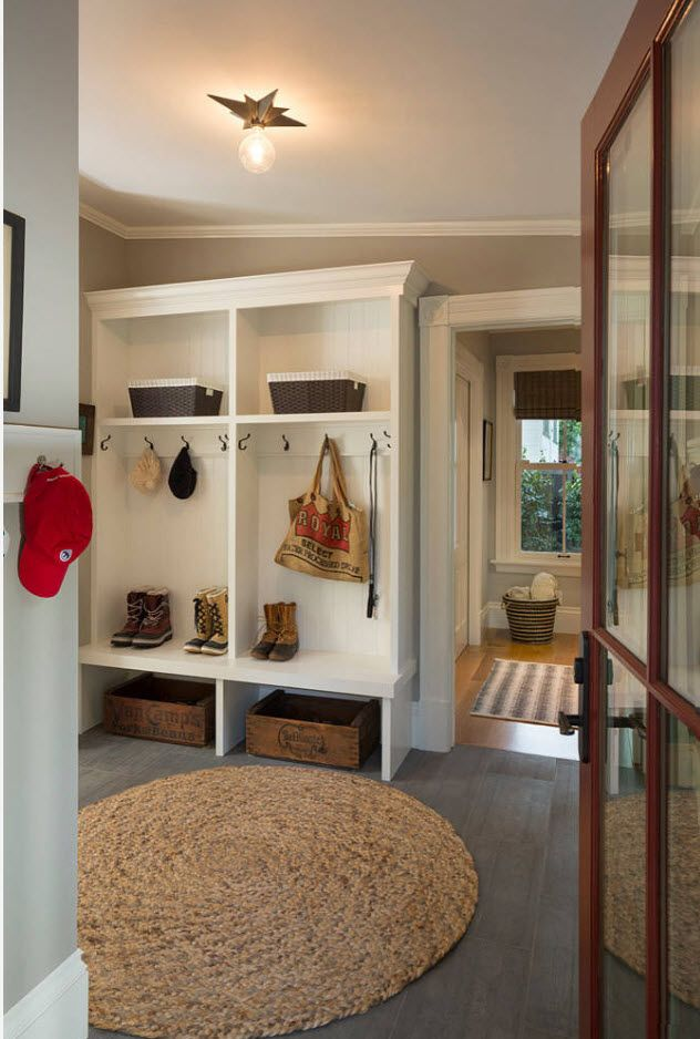 typical hallway with white wooden hanger set and storage