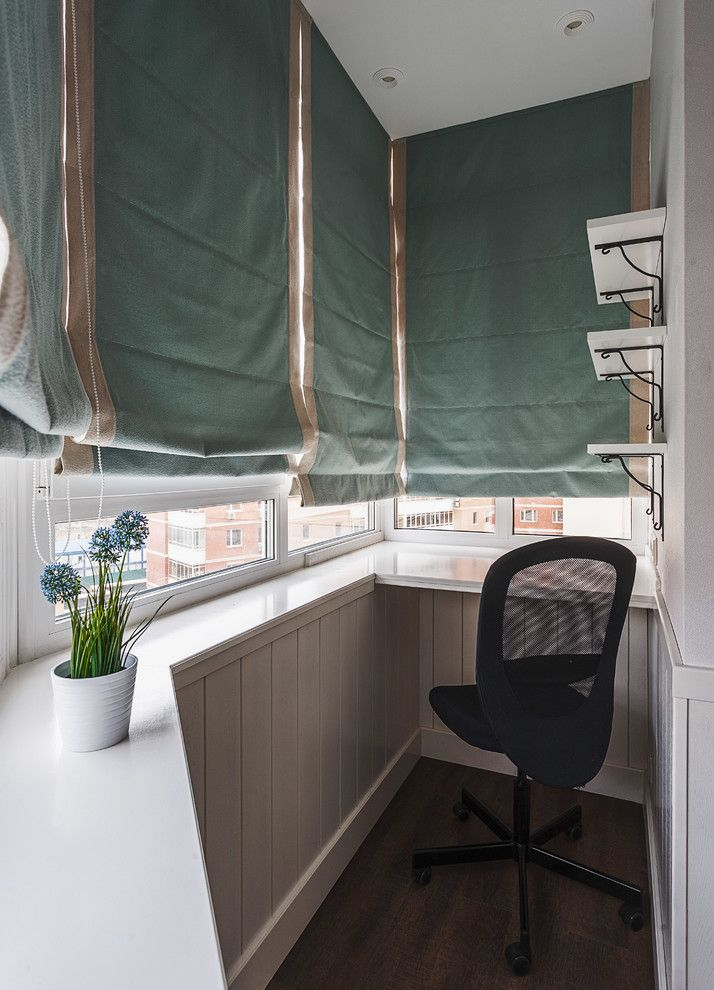 Cloth blinds at the balcony with windowsills as a countertops