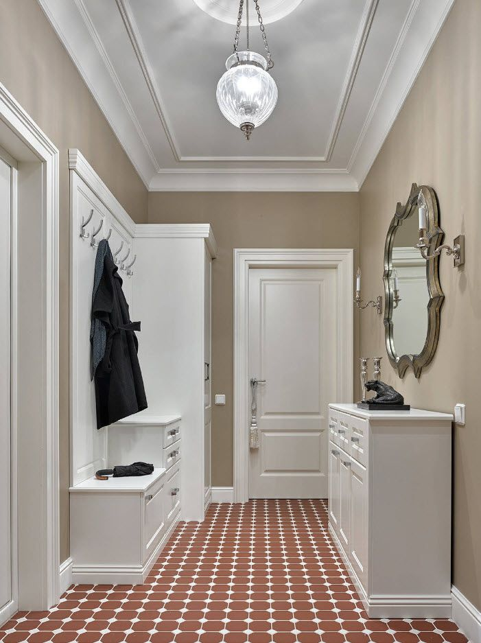 Classic interior design of the hallway with light beige wall paint