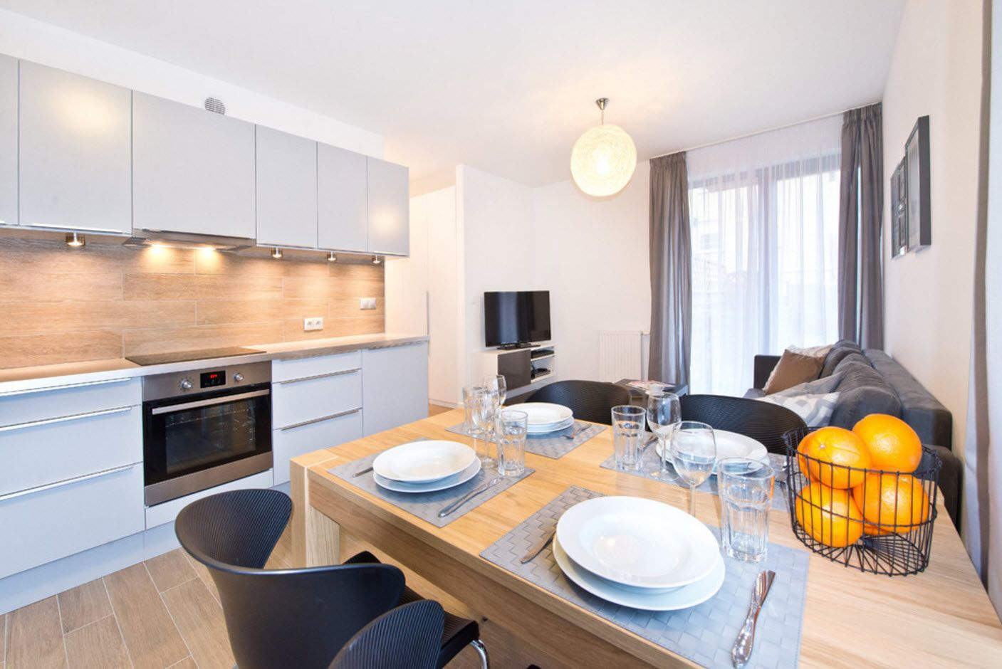 Kitchen, living, dining and relazing zones all combined