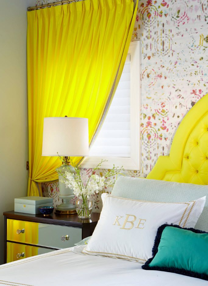 Yellow priscilla drapery and headboard of the royal bed