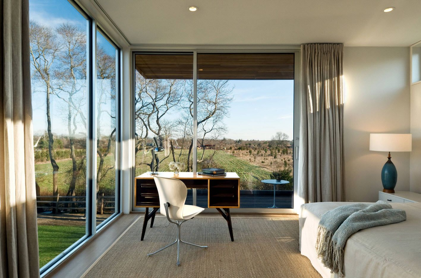 Countryside spectacular cottage in minimalistic hi-tech design with panoramice panel windows
