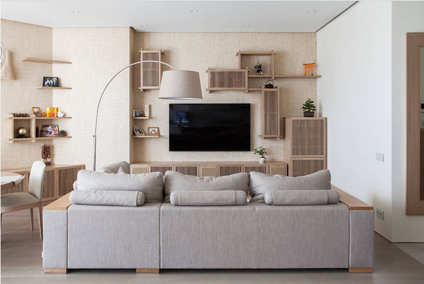 Gray steel sofa at the center of the zoned multifunctional living