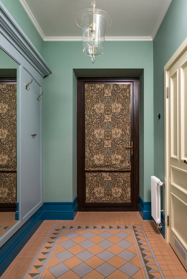 Daring turquoise wall paint in classic entrance hall