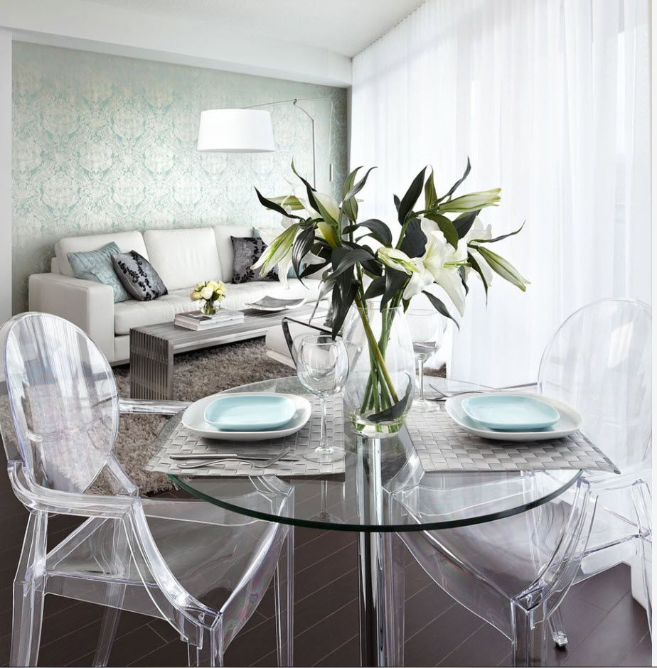 Plexiglass spectacular chairs at the modern white theme of the dining