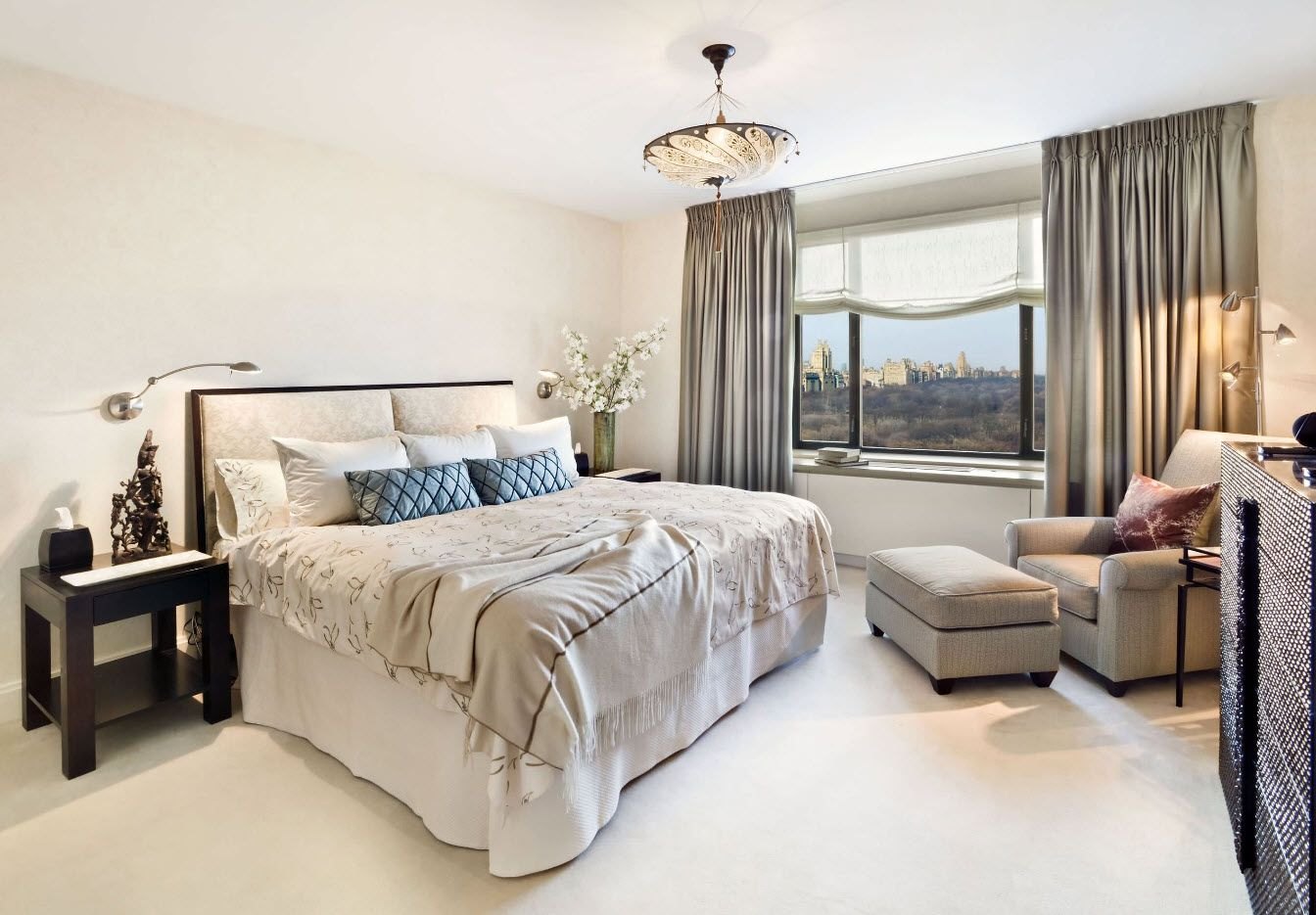 Gorgeous light color theme for the bedroom with gray drapes