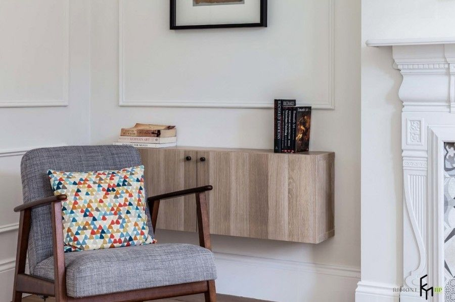 Modern English Country Style Interior Design Example. Suspended wooden texture cabinet and simple classic form of the armchair