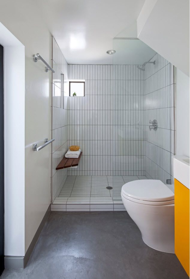 Minimalistic ascetic white bathroom with glass shower and yellow suspended vanity