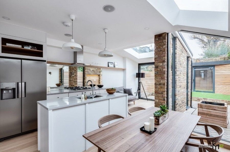 Modern English Country Style Interior Design Example. Spectacular brick partition at the kitchen separating the dining zone