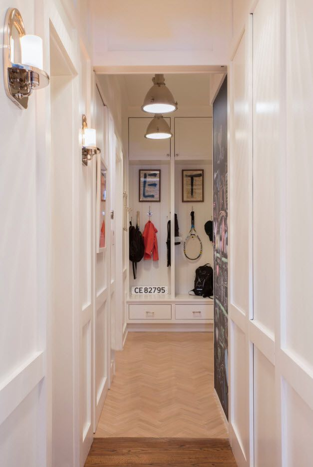 Narrow hallway in the classic white decoration