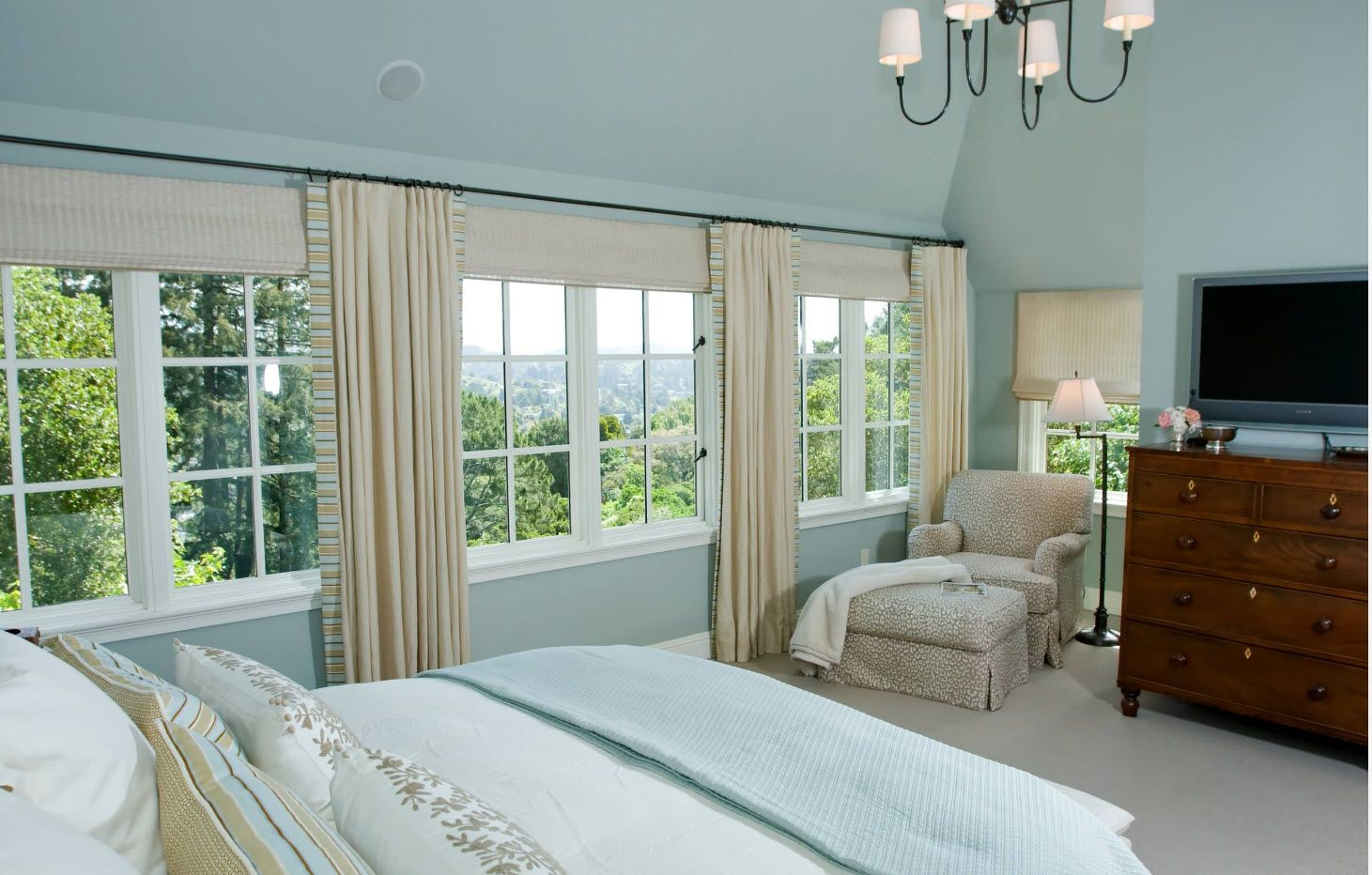 Light blue bedroom color with creamy brown draperies