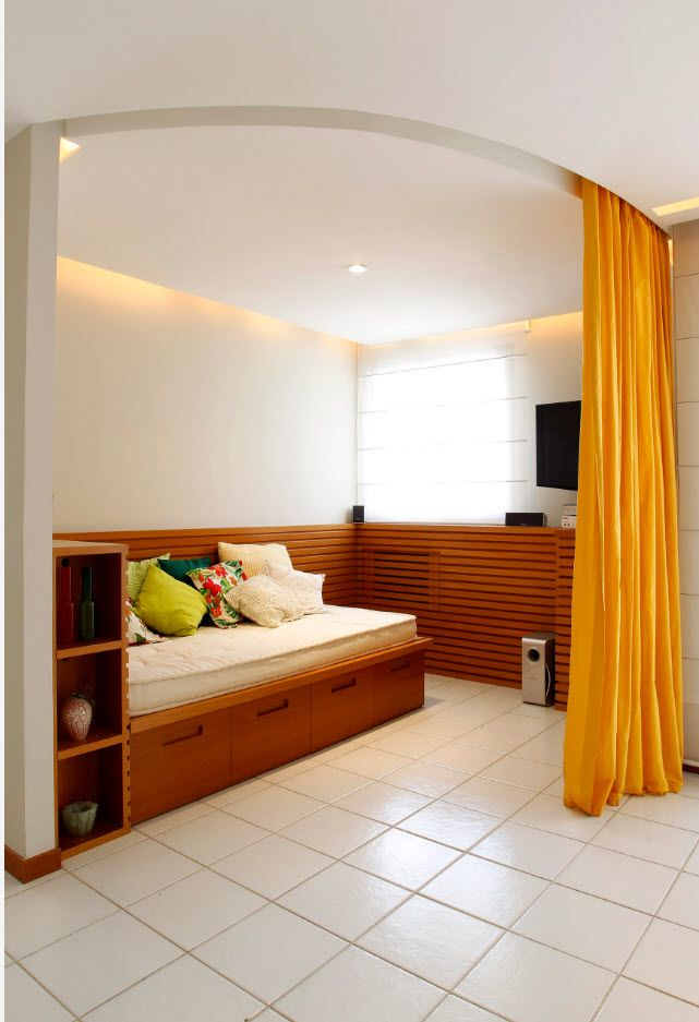 Zoning yellow draperies in the minimalism studio apartment