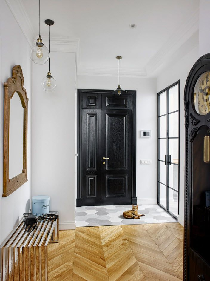 Dark door is an accent in the white interior