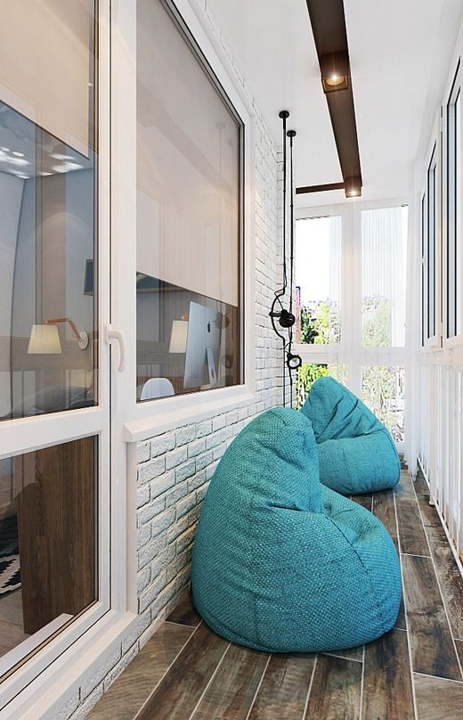 brickwork and frameless chairs at the balcony