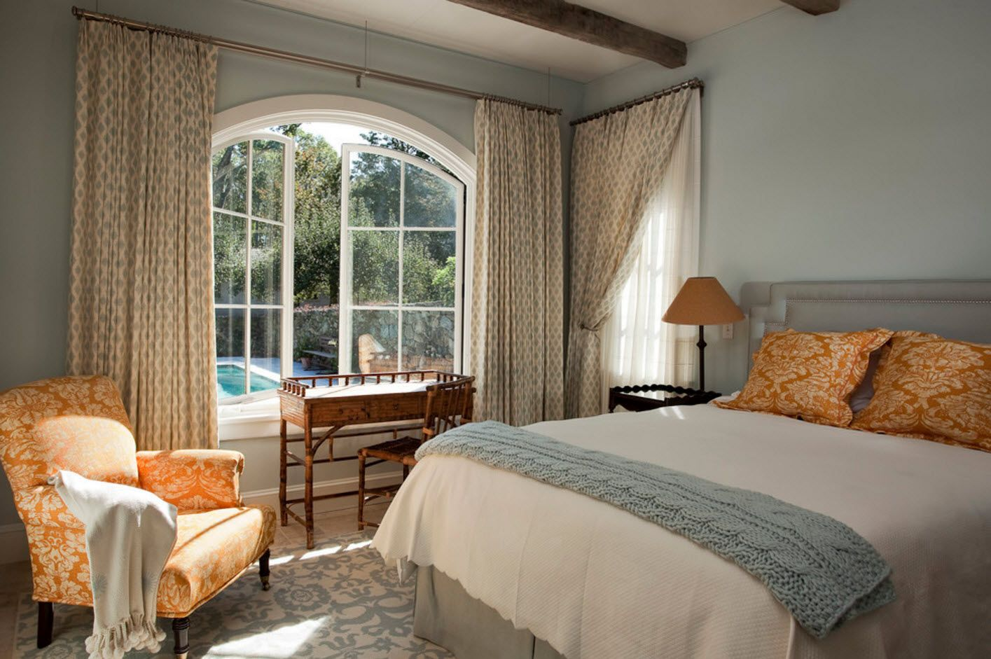 Latticed arch window in the classic olive colored bedroom interior