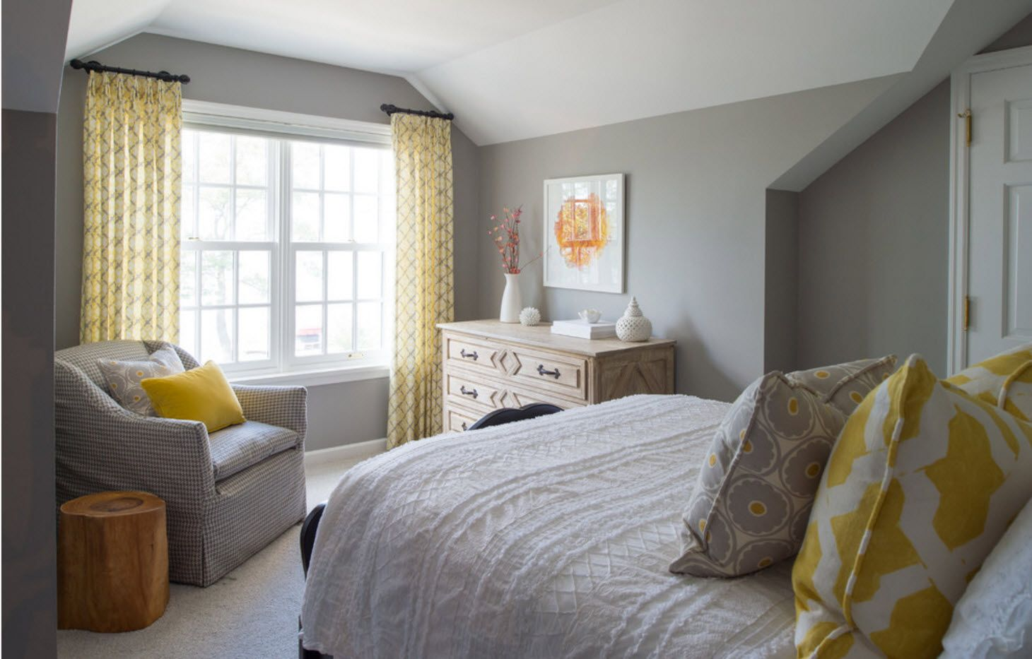 Gray setting of the modern bedroom with accentual yellow tulle curtains