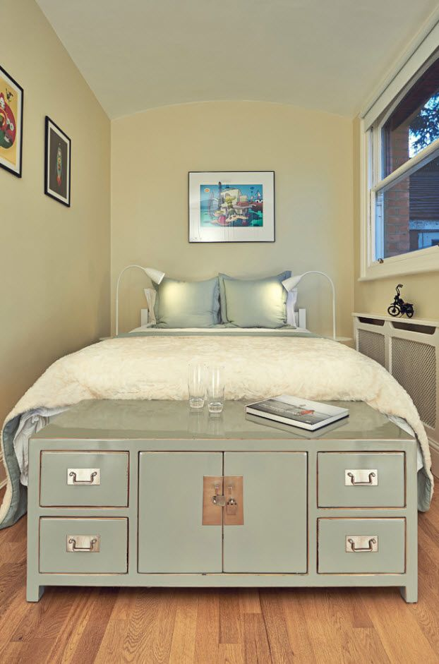 Typical classic designed interior of the creamy finished bedroom