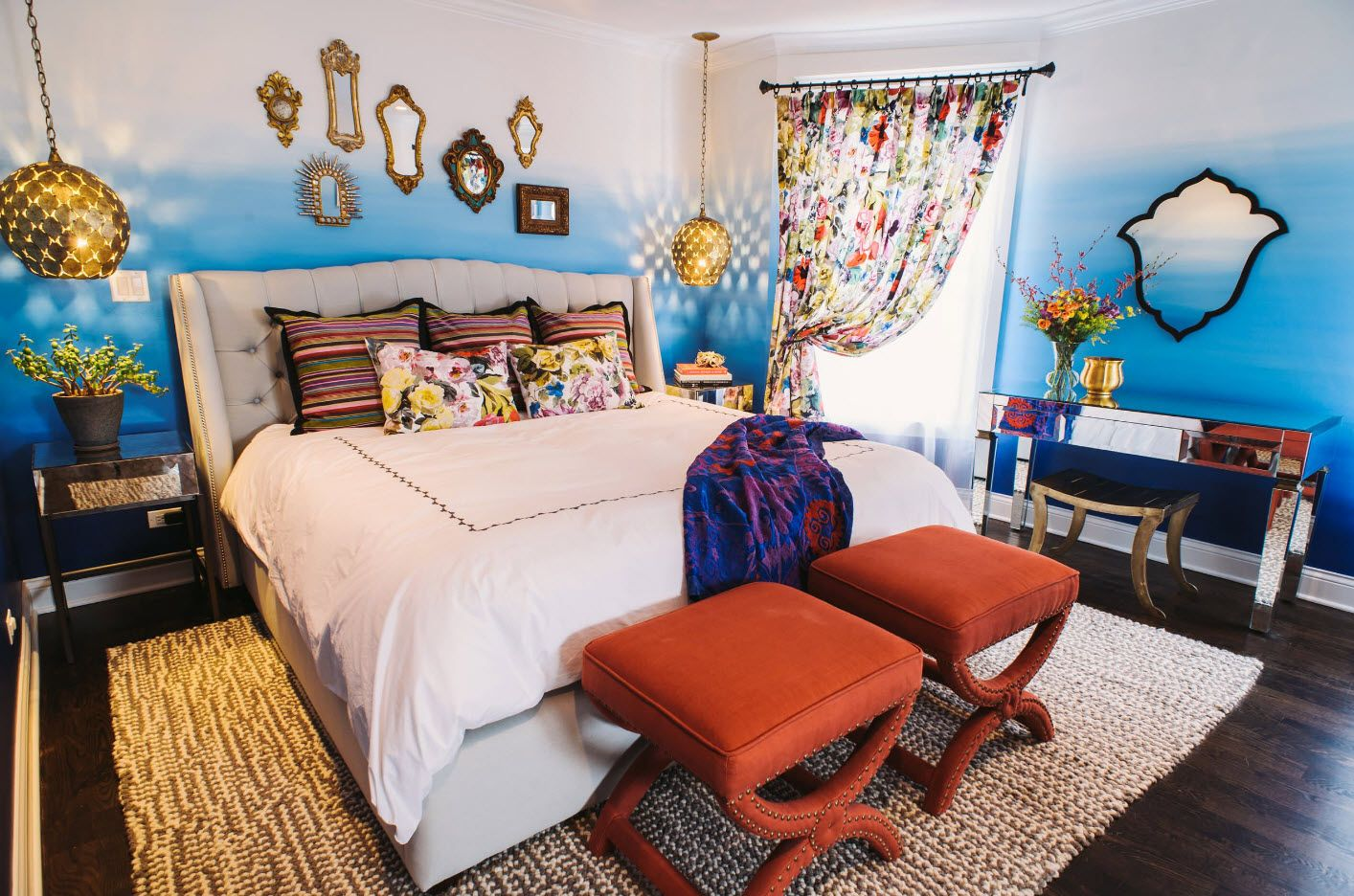 Red chairs at the footboard of the interesting style decorated walls bedroom