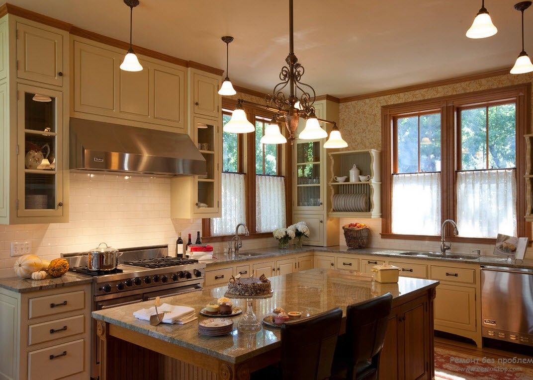 Victorian and modern mix of styles in the kitchen with smooth glance surfaces of the marble counterop and island