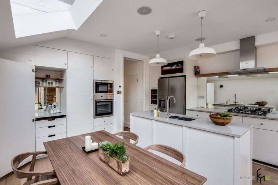 Modern English Country Style Interior Design Example. Gorgeous table with solid wood top at the speckless white kitchen