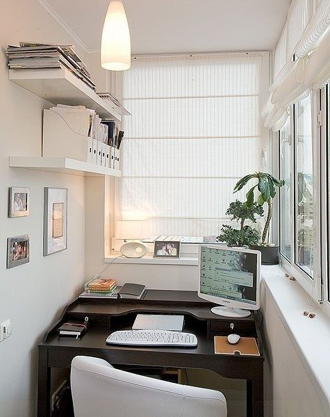 Balcony home office with roman blinds
