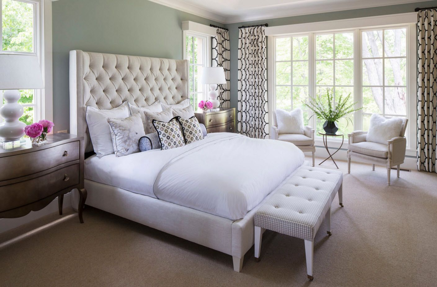 Quilted headboard at the classic bedroom with grommet top draperies with pattern