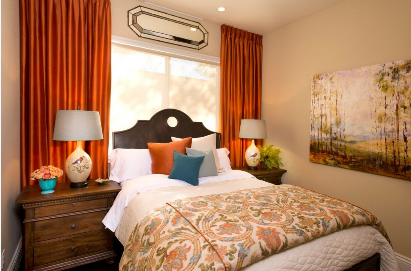 Colorful vintage decorated bedroom with orange dare draperies