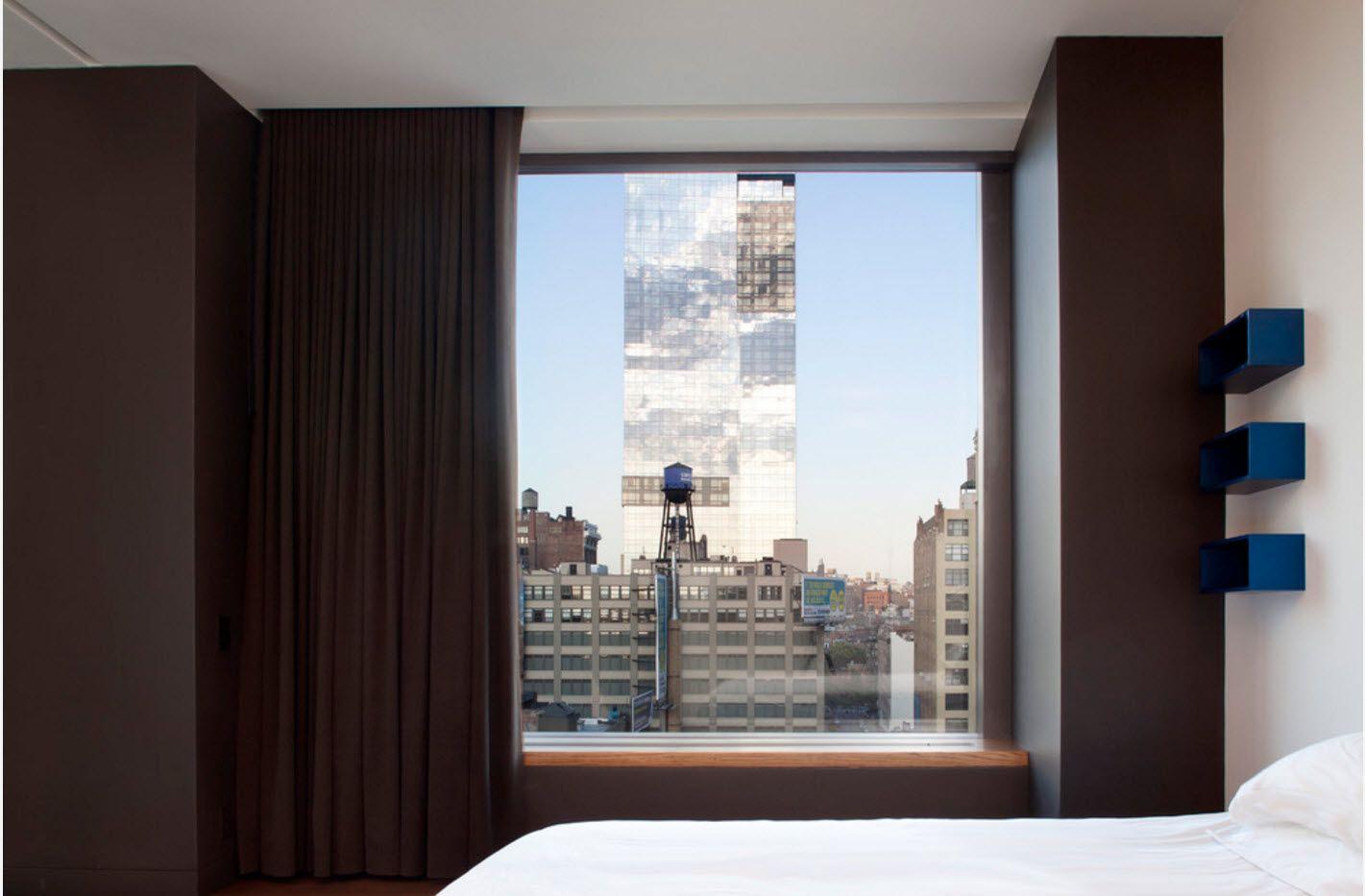 Modern urban interior with floor-to-ceiling blackout dark curtains