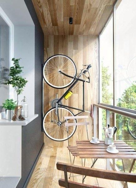 Bike at the wooden trimmed balcony